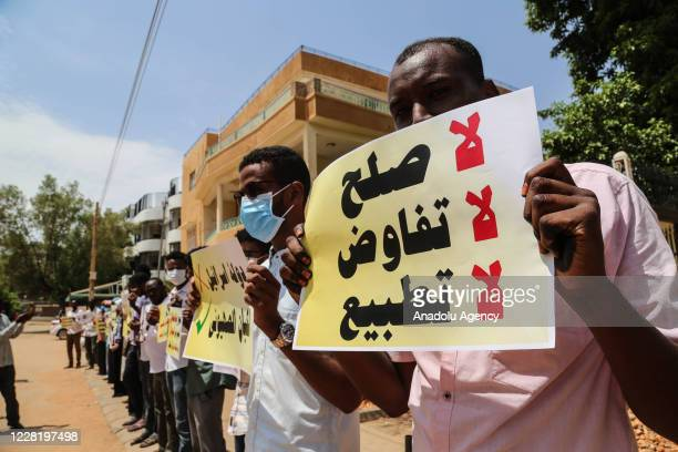 Sudanese people gather to protest the deal between the United Arab Emirates and Israel to normalize ties on August 25, 2020 in Khartoum, Sudan.
