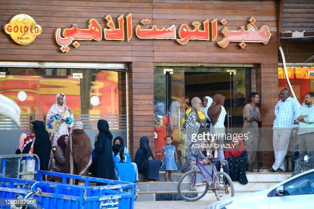 Sudanese people line up outside a bakery in order to buy bread in the capital Khartoum on February 11 2020 More than a year after the start of a...