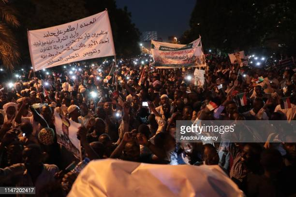 Sudanese people member of Islamic groups attend a march to demonstrate in support of transitional military council in front of presidential palace in...