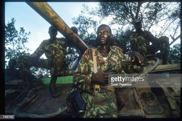Sudanese People's Liberation Army soldiers sit atop a tank November 13, 1993 in southern Sudan. SPLA members were offered amnesty in exchange for...