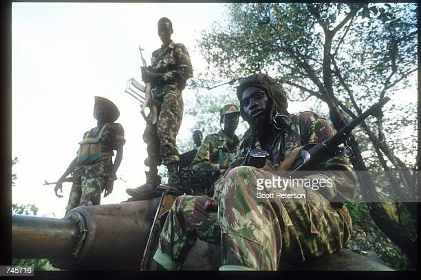 Sudanese People's Liberation Army soldiers stand atop a tank November 13, 1993 in southern Sudan. SPLA members were offered amnesty in exchange for...