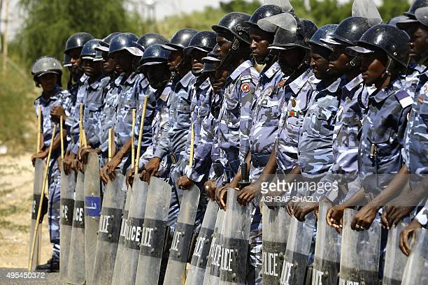 Sudanese police stand guard outside the US embassy during a demonstration in the capital Khartoum on November 3 to protest against sanctions imposed...