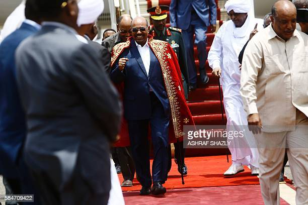 Sudanese President Omar alBashir arrives at the airport on July 30 2016 in the capital Khartoum Omar alBashir was honoured during a ceremony upon his...