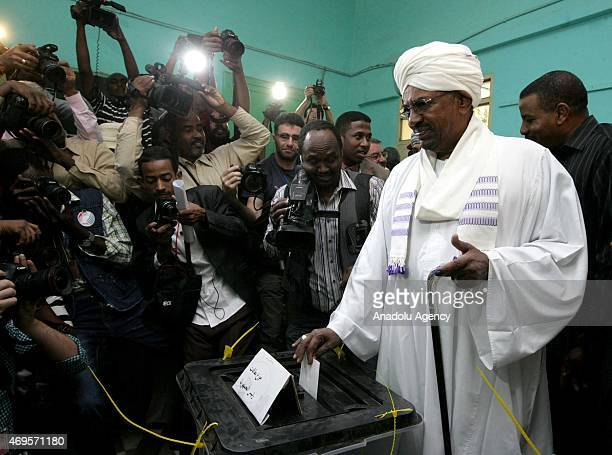 Sudanese President Omar al-Bashir casts his ballot in the presidential and parliamentary elections at a polling station in Khartoum, Sudan on April...