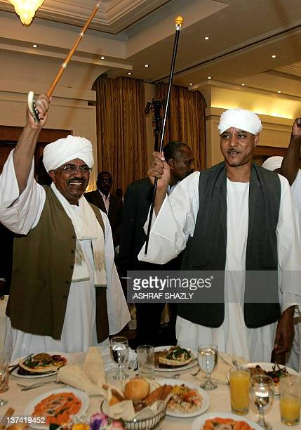 Sudanese President Omar alBashir dances with Sudan's Janjaweed militia leader Mussa Hilal during an official ceremony celebrating the marriage of the...