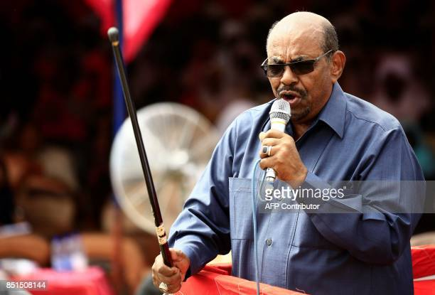 Sudanese President Omar alBashir delivers a speech during a visit to the village of Bilel in South Darfur near the Kalma camp for displaced people on...