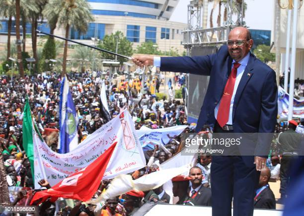 Sudanese President Omar alBashir greets the people as they stage a demonstration in support of the agreement between South Sudanese government and...