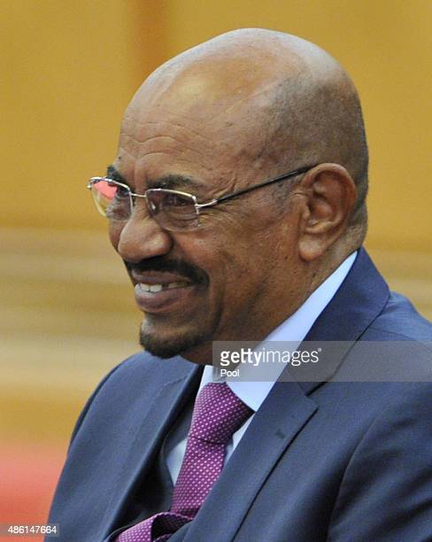Sudanese President Omar alBashir laughs during a meeting with Chinese President Xi Jinping at the Great Hall of the People on September 1 2015 in...