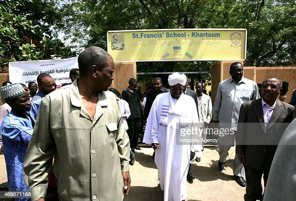 Sudanese President Omar al-Bashir leaves a polling station after casting his ballot in the presidential and parliamentary elections in Khartoum,...