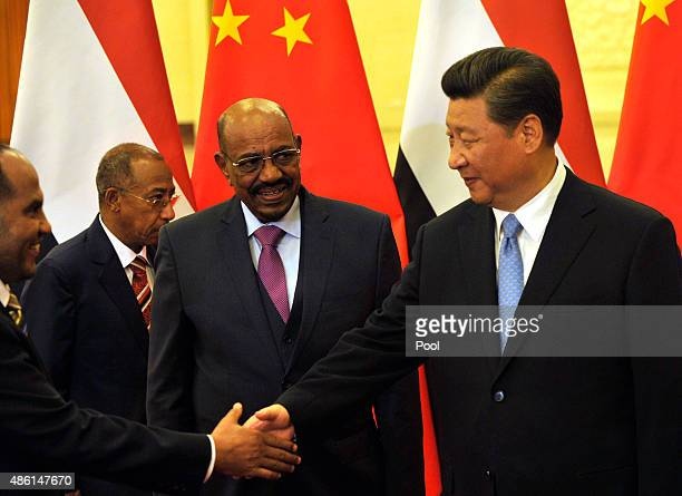 Sudanese President Omar al-Bashir looks at Chinese President Xi Jinping before their meeting at the Great Hall of the People on September 1, 2015 in...