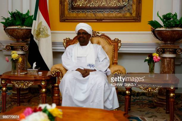 Sudanese President Omar alBashir meets with Qatari Foreign Minister Sheikh Mohammed bin Abdulrahman alThani in the capital Khartoum on March 11 2018...