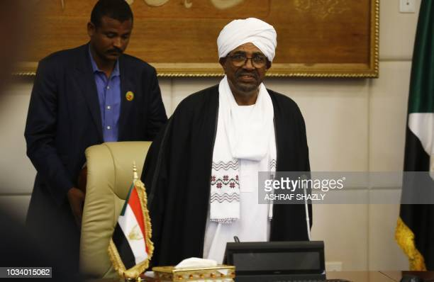 Sudanese President Omar alBashir overseas the new ministers sworn in at the presidential palace in the capital Khartoum on September 15 2018 Sudan's...