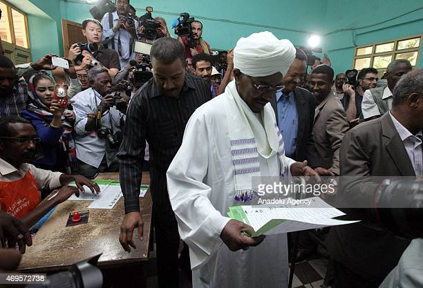 Sudanese President Omar alBashir prepares to cast his ballot in the presidential and parliamentary elections at a polling station in Khartoum Sudan...