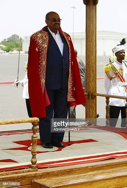Sudanese President Omar alBashir reviews troops during a welcome ceremony upon his arrival at the airport on July 30 2016 in the capital Khartoum...