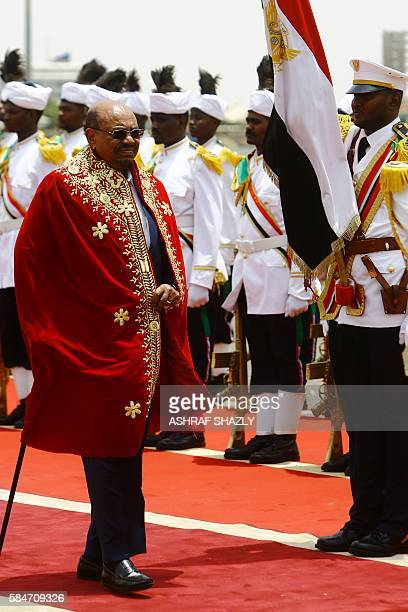 Sudanese President Omar alBashir reviews troops upon his arrival at the airport on July 30 2016 in the capital Khartoum Omar alBashir was honoured...