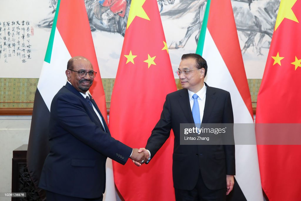Sudanese President Omar al-Bashir (L) shakes hands with Chinese Premier Li Keqiang (R) at Diaoyutai State Guesthouse on September 2, 2018 in Beijing, China.