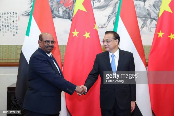 Sudanese President Omar al-Bashir shakes hands with Chinese Premier Li Keqiang at Diaoyutai State Guesthouse on September 2, 2018 in Beijing, China.