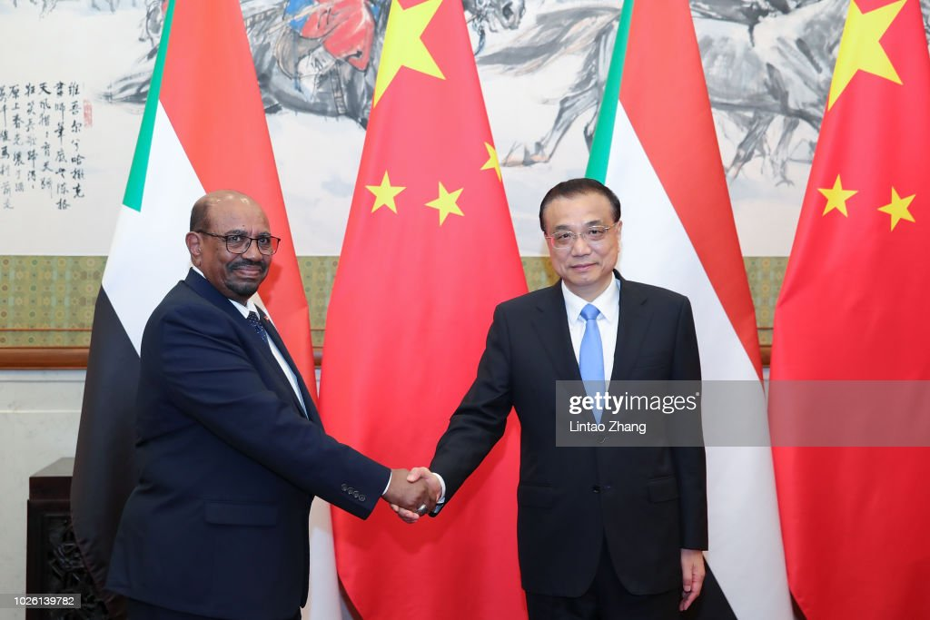 Sudanese President Omar al-Bashir (L) shakes hands with Chinese Premier Li Keqiang at Diaoyutai State Guesthouse on September 2, 2018 in Beijing, China.