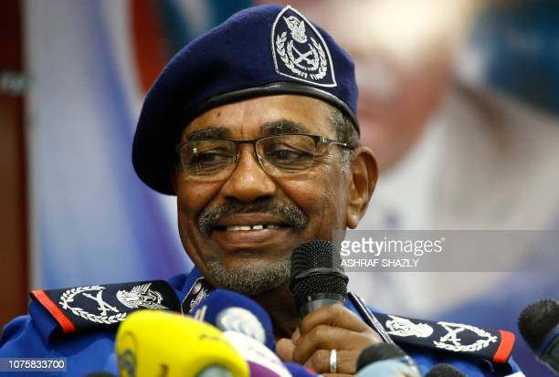 Sudanese President Omar alBashir speaks during a meeting with police officials at the headquarters of the police house in the capital Khartoum on...