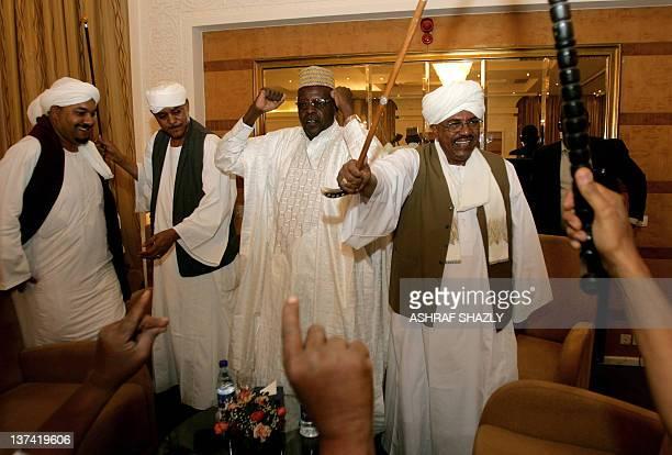 Sudanese President Omar alBashir Sudan's Janjaweed militia leader Mussa Hilal and Abdullah Nagi representative of Chadian President Idriss Deby dance...
