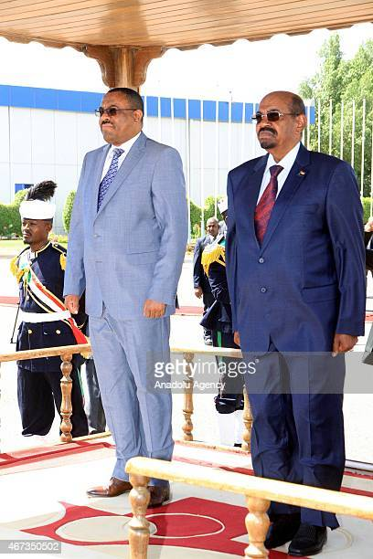 Sudanese President Omar alBashir welcomes Ethiopian Prime Minister Hailemariam Desalegn in Khartoum Sudan on March 23 2015