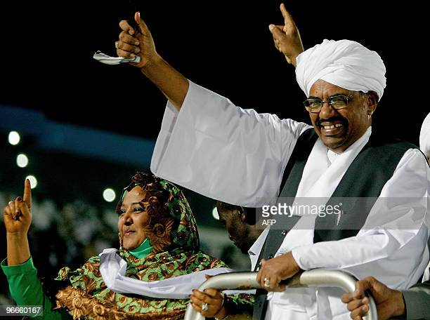 Sudanese President Omar alBeshir arrives to a campaign rally with his second wife Widad Babiker at AlHilal Stadium in Khartoum on February 13 2010...