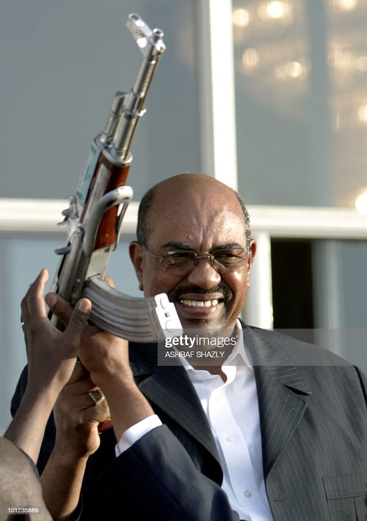 Sudanese President Omar al-Beshir holds an automatic rifle as he greets the crowd during a rally paying hommage to women's role in Sudan's military held in Khartoum on May 27, 2009. The International Criminal Court (ICC), the world's only permanent tribunal for crimes against humanity and genocide, issued in March an arrest warrant against the Sudanese president on charges of war crimes in Darfur, accusing him of orchestrating a campaign of murder, torture, rape and pillage in the war-battered western Sudanese region. Beshir has refused to cooperate with the ICC.