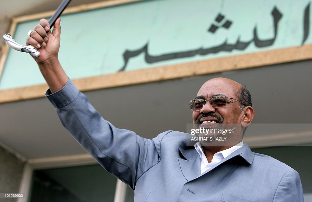 Sudanese President Omar al-Beshir waves his stick in the air during a campaign rally for the upcoming general elections in Khartoum on January 20, 2009. The rally was attended by Khartoum-based southern Sudanese supporters of the president, who is due to stand for re-election in April. Beshir said on January 19 Sudan will recognise the south's independence if it chooses to secede in the January 2011 referendum, and the north 'will be good a neighbour'.