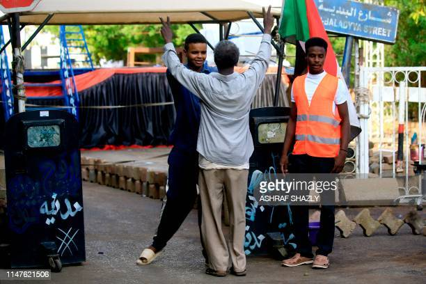 A Sudanese protester checks a man in Khartoum on June 2 2019 The military ousted president Omar alBashir in April after months of protests against...