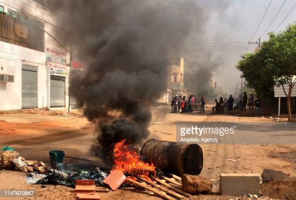 Sudanese protesters block main roads to army headquarters with burning tyres and pavers in Khartoum, Sudan on June 3, 2019. At least five protesters...