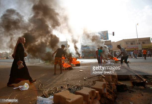 Sudanese protesters block Street 60 with burning tyres and pavers as military forces tried to disperse a sit-in outside Khartoum's army headquarters...