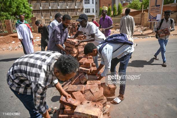 Sudanese protesters build a makeshift barricade during a sitin outside the army headquarters in the capital Khartoum on April 30 2019 Tensions are...