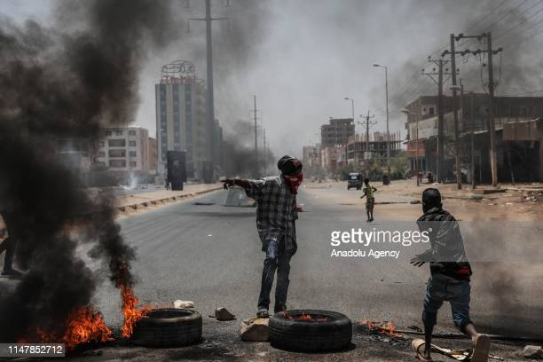 Sudanese protesters burn tyres and set up barricades on roads to army headquarters after the intervention of Sudanese army, during a demonstration in...