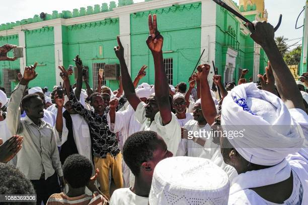 Sudanese protesters chant slogans against President Omar alBashir during a demonstration in the capital Khartoum's twin city of Omdurman on January...