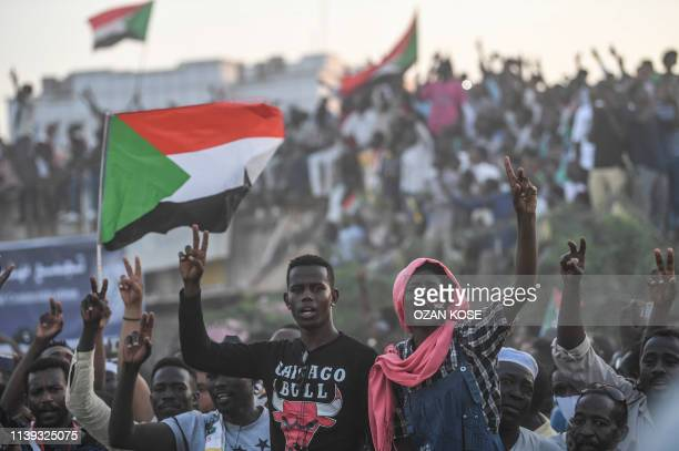 Sudanese protesters chant slogans as they gather for a millionstrong march outside the army headquarters in the capital Khartoum on April 25 2019...