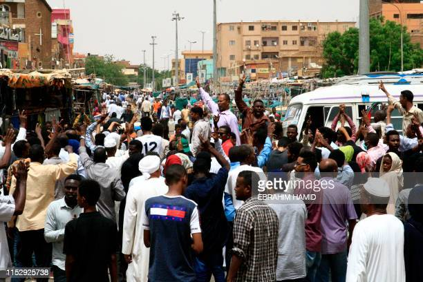 Sudanese protesters chant slogans during a mass demonstration against Sudan's ruling generals in the northern Khartoum district of Bahri on June 30...
