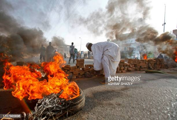 Sudanese protesters close Street 60 with burning tyres and pavers as military forces tried to disperse a sitin outside Khartoum's army headquarters...