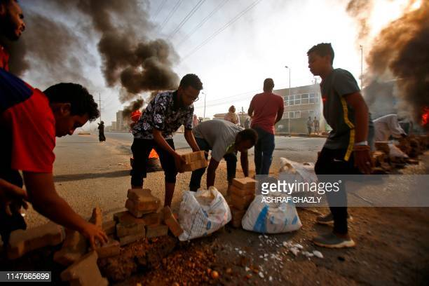 Sudanese protesters close Street 60 with burning tyres and pavers as military forces tried to disperse a sit-in outside Khartoum's army headquarters...