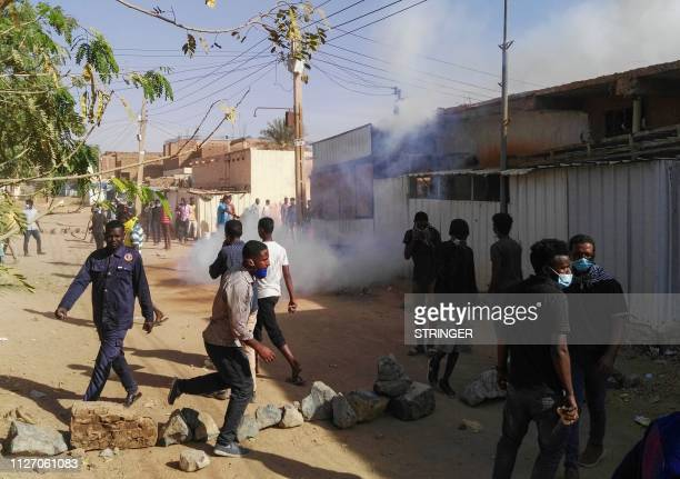 Sudanese protesters demonstrate against their government in the capital Khartoum's district of Burri on February 24 2019 Riot police swiftly...