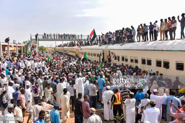 Sudanese protesters from the city of Atbara arrive at the Bahari station in Khartoum on August 17 to celebrate transition to civilian rule. - Sudan...