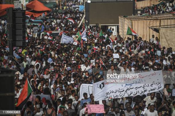Sudanese protesters from the city of Kassala arrive to join the sitin outside the army headquarters in the capital Khartoum on April 27 2019 A joint...