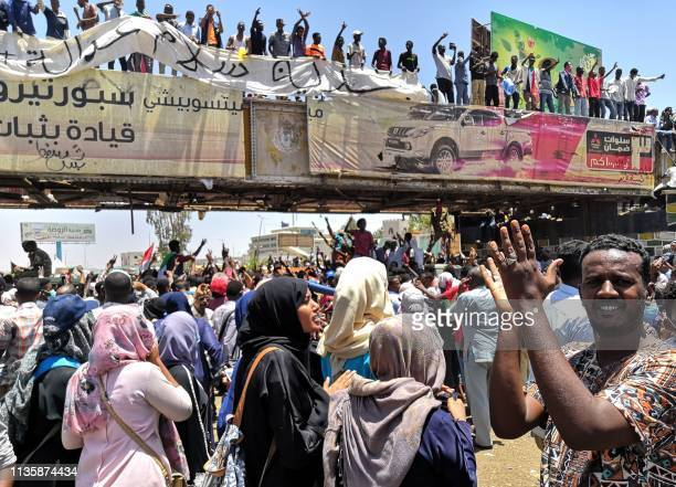 TOPSHOT Sudanese protesters rally in front of the military headquarters in the capital Khartoum on April 8 2019 Sudan's army deployed around its...