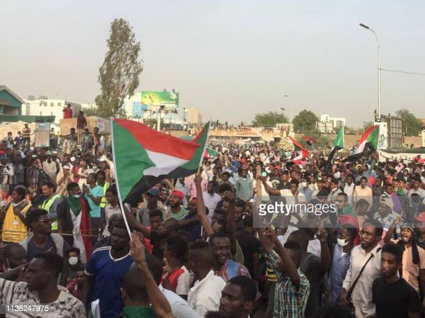Sudanese protesters rally in front of the military headquarters in the capital Khartoum on April 11 2019 The Sudanese army is planning to make an...