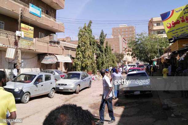 Sudanese protesters run away from tear gas smokes during a demonstration in Khartoum on December 31 2018 Police fired tear gas at protesters in...