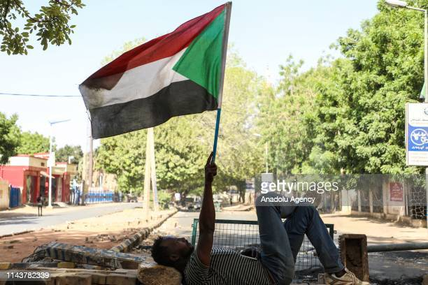 Sudanese protesters use barricades to block main roads as they gather to protest over killing of protestors in Khartoum, Sudan on May 14, 2019. On...