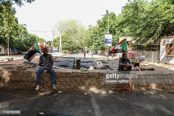 Sudanese protesters use barricades to block main roads as they gather to protest over killing of protestors in Khartoum Sudan on May 14 2019 On...