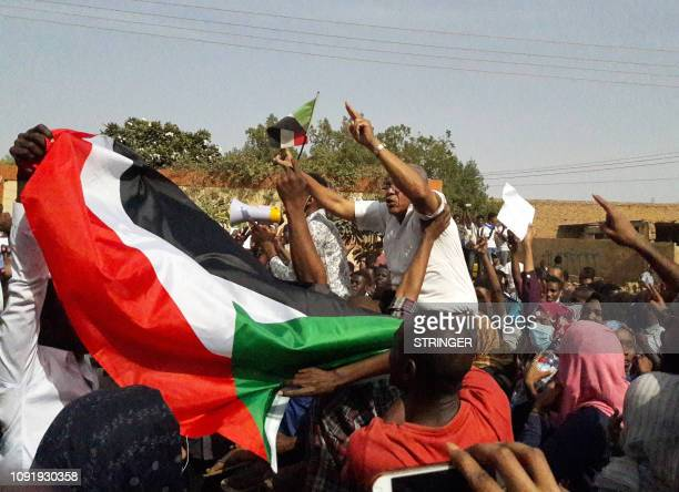Sudanese protesters wave their national flag and chant slogans during an antigovernment demonstration in the capital Khartoum's twin city of Omdurman...