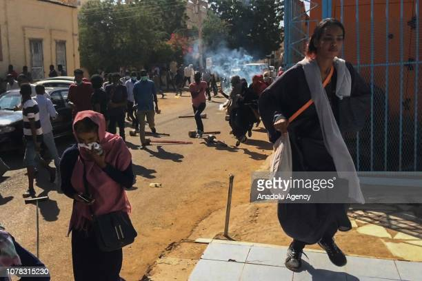Sudanese protesterseffected by tear gas cover their faces during an antigovernment demonstration in the capital Khartoum on January 6 2018