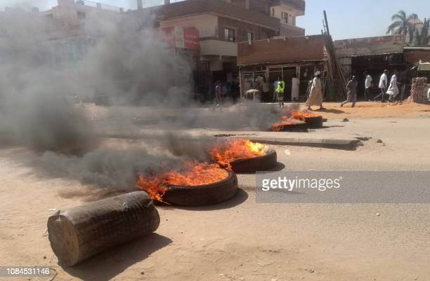 Sudanese protestors burn tires during an antigovernment demonstration on January 18 2019 in the capital Khartoum Deadly protests have rocked Sudan...
