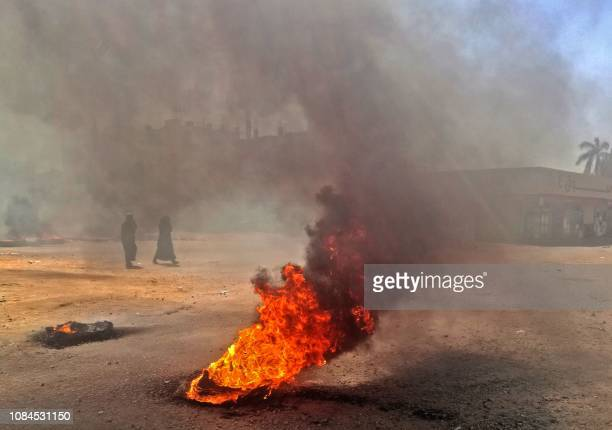 TOPSHOT Sudanese protestors burn tires during an antigovernment demonstration on January 18 2019 in the capital Khartoum Deadly protests have rocked...